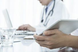 Physician is showing an electronic tablet
